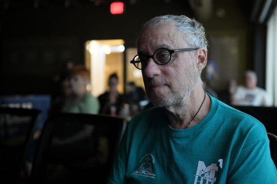 Tom Zerafa, 68, of Oak Park watches the debate at an ACLU of Michigan watch party.