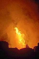A fire burns after an explosion near Junction City, Ky. A regional gas pipeline owned by Enbridge ruptured early Thursday in Kentucky, causing a massive explosion that killed one person, hospitalized five others, destroyed railroad tracks and forced the evacuation of a nearby mobile home park, authorities said.