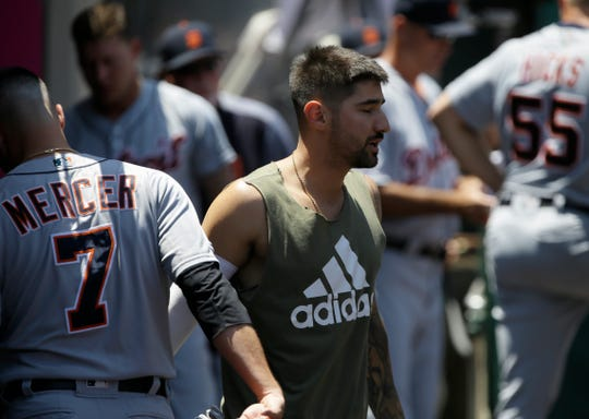 Detroit Tigers' Nicholas Castellanos, right, says farewell to Jordy Mercer in the dugout, after Castellanos is traded to the Chicago Cubs, during the first inning Wednesday.