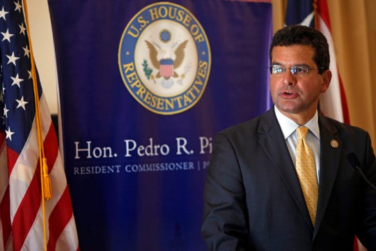 In this Sept. 24, 2013 file photo, Pedro Pierluisi, Puerto Rico's representative in the U.S. Congress, speaks during a conference in San Juan, Puerto Rico. A Puerto Rico legislator said Tuesday, July 30, 2019, that the U.S. territory's embattled governor plans to nominate Pierluisi as secretary of state.