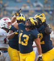 Michigan running back Tru Wilson is the team's leading returning rusher.