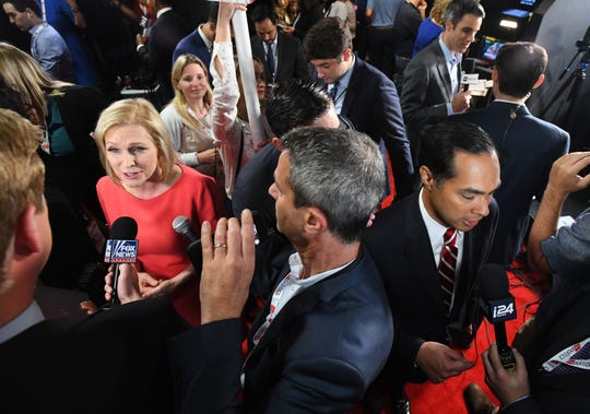 New York Sen. Kirsten Gillibrand and former Housing and Urban Development Secretary Julian Castro answer questions from the media after the second Democratic presidential debate