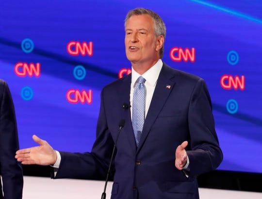 New York City Mayor Bill de Blasio participates in the debate.