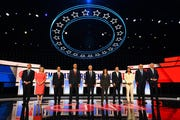 Democratic presidential hopefuls (from left) Colorado Sen. Michael Bennet, New York Sen. Kirsten Gillibrand, former Housing and Urban Development Secretary Julian Castro, New Jersey Sen. Cory Booker, former Vice President Joe Biden, California Sen. Kamala Harris, businessman Andrew Yang, Hawaii Rep. Tulsi Gabbard, Washington state Gov. Jay Inslee and New York City Mayor Bill de Blasio take their places on stage before the start of the second night of Democratic presidential debates at the Fox Theatre in Detroit, Wednesday.