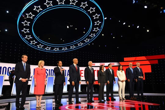 Democratic candidates (from left) Colorado Sen. Michael Bennet, New York Sen. Kirsten Gillibrand, former Housing and Urban Development Secretary Julian Castro, New Jersey Sen. Cory Booker, former Vice President Joe Biden, California Sen. Kamala Harris, businessman Andrew Yang, Hawaii Rep. Tulsi Gabbard, Washington state Gov. Jay Inslee and New York City Mayor Bill de Blasio stand on stage before the start of the Democratic presidential debate at the Fox Theatre in Detroit.