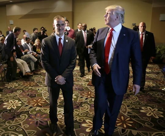 In this Aug. 25, 2015 file photo, Republican presidential candidate Donald Trump walks with his campaign manager Corey Lewandowski, left, after speaking at a news conference in Dubuque, Iowa.