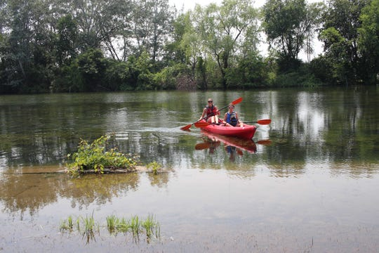 Meredith Zammit-Julius, 29, of Royal Oak and her niece, Isabella Zammit, 11, of Lathrup Village were out kayaking on swollen waters of the Belle Isle canal in July.