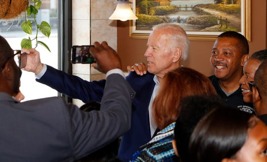 Former Vice President Joe Biden, a Democratic presidential candidate, takes a selfie during a campaign stop in Detroit.