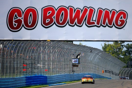Chase Elliott takes the checkered flag to win the 2018 Go Bowling at The Glen at Watkins Glen International.