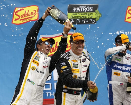 Christian Fittipaldi and Joao Barbosa celebrate in victory lane at Watkins Glen International after winning the Sahlen's Six Hours of The Glen in 2016.