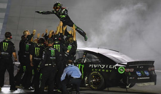 Kurt Busch celebrates with his team after winning the Quaker State 400 by Walmart at Kentucky Speedway on July 13, 2019.