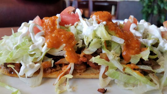 A huarache with beef and chorizo at Chicken 'n Salsa Mexican Restaurant.