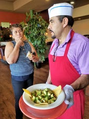 Jose Mosqueda of Chicken 'n Salsa chats with Teresa Alfaro of Los Alfaro during a recent lunch on Friday, July 26, 2019.