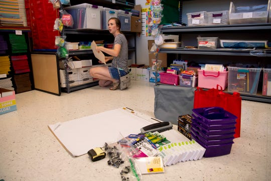 Larissa Ewing, a 2019 University of Southern Indiana graduate, gathers school supplies for her first year of teaching at Cedar Hall Elementary School at the Evansville Vanderburgh School Corporation's Teacher Locker recently. The Teacher Locker offers first-year teachers a chance to pick up school supplies to get them started in their classrooms.