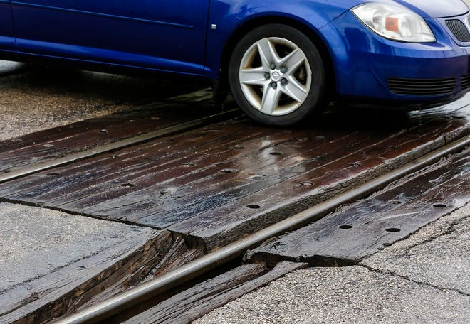 A car passes over the railroad tracks Friday, May 24, 2019 on Division Street in Fond du Lac, Wis. Doug Raflik/USA TODAY NETWORK-Wisconsin