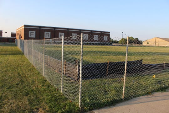 Contractors have put up fences around the new construction site at Fremont Ross High School. Superintendent Jon Detwiler said he hopes that by next week, the school district will have established a new traffic pattern around the construction area that will last through 2021.
