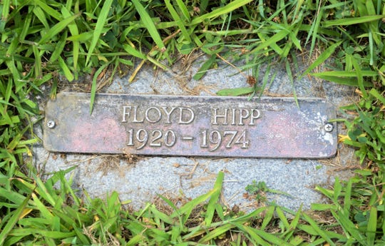 Grass is threatening to recover the grave of Floyd Hipp at the Sandusky County Cemetery. Hipp's stone is one of 23 stones Janet Ramirez and a handful of volunteers have discovered and cleared at the long-neglected cemetery.