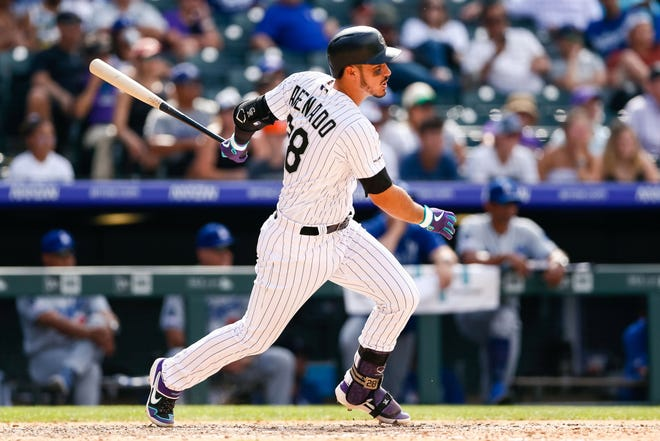 Colorado Rockies third baseman Nolan Arenado hits an RBI single Wednesday in a loss to the Los Angeles Dodgers at Coors Field in Denver. The Rockies begin a three-game home series against the San Francisco Giants at 6:40 p.m. Friday.