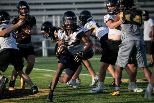 Bishop Verot High School football players practice on Thursday, August 1, 2019, in Fort Myers.