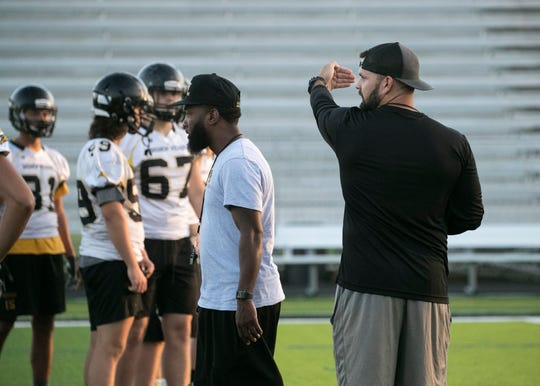 "Bishop Verot coach Josh Vogelbach works with his team at practice on Thursday, August 1, 2019, in Fort Myers. ""Our kids have done a phenomenal job this summer, being here with 7-on-7s, we always go to Valdosta every year and that helped us. We've hit the ground running,"" Vogelbach said."
