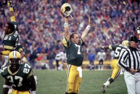 1989: Packers quarterback Don Majkowski (7) celebrates the instant-replay call confirming his game-winning touchdown pass to Sterling Sharpe against the Bears at Lambeau Field on Nov. 5, 1989. The Packers won, 14-13. Also celebrating are Perry Kemp (81),  Herman Fontenot (27) and Johnny Holland (50).