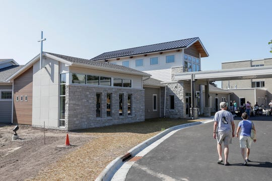 People walk up to the Door County Medical Center's newly constructed Skilled Nursing and Hospice Care Center during an open house Thursday, August 1, 2019, in Sturgeon Bay, Wis.