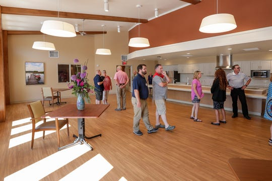People tour the kitchen during an open house at the Door County Medical Center's Skilled Nursing and Hospice Care Center Thursday, August 1, 2019, in Sturgeon Bay, Wis.