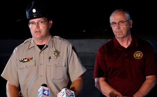 Clinton County (Mo.) Sheriff Larry Fish, left, said human remains that have not been positively identified were found Tuesday on a farm near Braymer, Missouri. Fish was joined by Caldwell County (Mo.) Sheriff Jerry Galloway, right, on Wednesday, July 31, 2019, in Polo, Mo. Authorities who had been searching a Missouri farm for two missing Wisconsin brothers announced Wednesday that human remains have been found there, more than a week after the pair disappeared during a trip for their livestock business. (Rich Sugg/The Kansas City Star via AP)