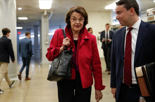 FILE - In this July 31, 2019 file photo Sen. Dianne Feinstein, D-Calif., the ranking member of the Senate Judiciary Committee, walks to the Senate chamber at the Capitol in Washington. Senators from California and Montana said Thursday, Aug. 1, 2019, they plan to introduce a bipartisan bill that aims to protect communities from wildfires like the one that killed 85 people and destroyed much of the Northern California town of Paradise last year.  (AP Photo/J. Scott Applewhite,File)