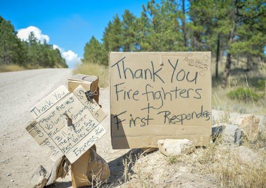 Darlene Jatkowski's handwritten thank-you sign to fire fighters and first responders displayed at the end of her driveway along Ferry Road in Helena. The North Hills Fire has burned 4,896 acres west of the Missouri River between Upper Holter Lake and Hauser Lake.