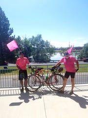 Bob Sherrill (right) and Pablo Jimenez (left), are biking more than 1,800 miles from Oregon to Minnesota to raise awareness for breast cancer.