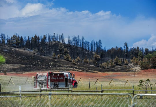 A fire engine monitors the fire line on the south end of the North Hills Fire along Noble Lane north Helena on Wednesday afternoon. The fire had burned 4,896 acres and was 50 percent contained by Wednesday night.