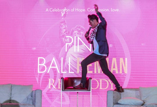 Filipino-Australian singer, Mig Ayesa, climbs onto the furniture as he offers a sample performance during a Pink Ball press conference at the Dusit Thani Guam Resort in Tumon on Thursday, Aug. 1, 2019. The theme of this year's black tie fundraiser is The Pink Ballhemian Rhapsody, scheduled for this Saturday, Aug. 3. Ayesa will be performing at the benefit event to help riase funds for the Harvest House, an organization that assists the local orphans community.