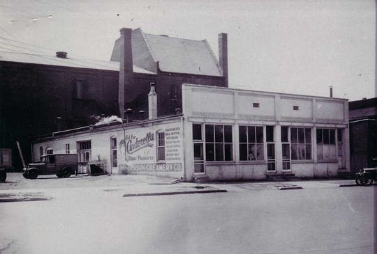 The Henderson Creamery Co. at 120 First St. depicted about 1930. The rear portion of the Grand Theater, which burned March 9, 1933, can be seen at rear. The creamery, which was a big supporter of local dairymen in their 1944 fight with the federal government,  operated for a lengthy period and in recent times the building has housed restaurants.