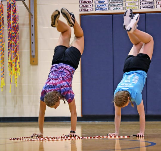 Indy Air Bears jumpers Grace LaVier, left, and Elise McQueen practice for world competition, Wednesday, June 12, 2019. The performance-based team competes locally, nationally and internationally. In July 2019, 12 members of the team, including these jumpers, traveled to Oslo, Norway, to compete in the World Jump Rope (WJR) Championship.