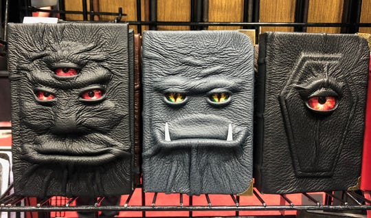 Abbots Hollow Studios sells notebooks, wallets, bookmarks and more that are adorned with these funky faces.