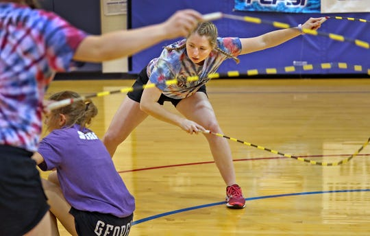 Indy Air Bears' Katie Tyson, right, swings ropes as she and her teammates practice for world competition, Wednesday, June 12, 2019.  The performance-based team competes locally, nationally and internationally. In July 2019, 12 members of the team, including these jumpers, traveled to Oslo, Norway, to compete in the World Jump Rope Championship.