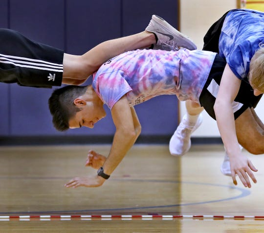 Indy Air Bears jumpers Denver Hammons, from left, Eric Hinojosa and Blake Long practice for world competition, Wednesday, June 12, 2019.  The performance-based team competes locally, nationally and internationally. In July 2019, 12 members of the team, including these jumpers, traveled to Oslo, Norway, to compete in the World Jump Rope Championship.