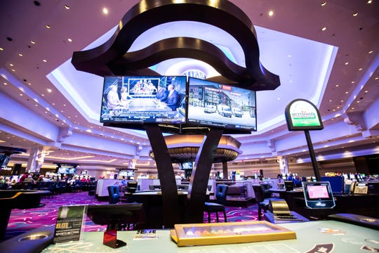 Televisions play sports shows on the casino floor above table games near the recently opened Draft Day sports betting lounge Thursday, Aug. 1, 2019, at the Riverside Casino in Riverside, Iowa.