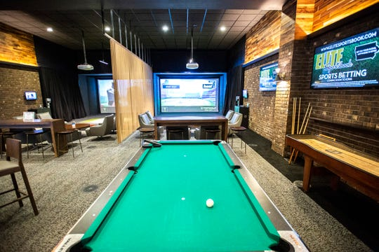 A pool table is pictured near Top Golf suites inside the recently opened Draft Day sports betting lounge is pictured, Thursday, Aug. 1, 2019, at the Riverside Casino in Riverside, Iowa.  Draft Day is part of the Elite Sportsbook group of sports betting facilities across eastern Iowa.