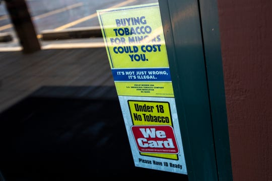A sign warns against under age tobacco use, Thursday, Aug. 1, 2019, in Riverside, Iowa.