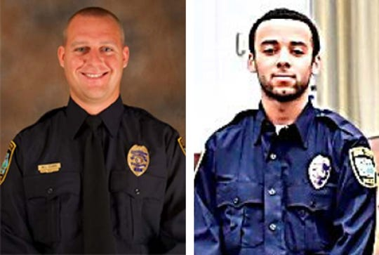 Iowa City police officers Michael Clark, left, and  Trai Bunch.