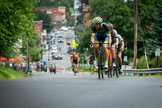 Cyclists in last year's T-burg Crit make it up Old Main Street in Trumansburg in the final stretch of the day-long race.