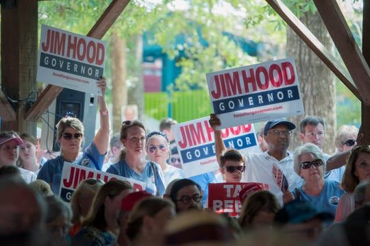 Gubernatorial candidate Jim Hood supporters spill over outside the boundries of the pavilion to surrounding Founders Square at the Neshoba County Fair Thursday morning as candidates for governor gave 10-minute orations to large crowds gatered for the traditional stump speeches.