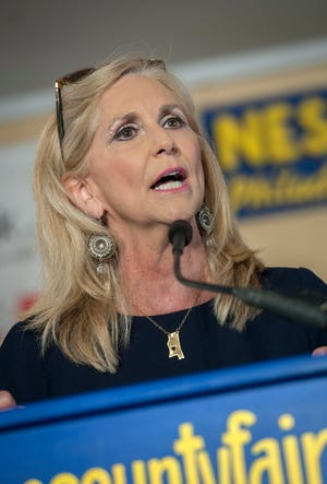 Lynn Fitch, Republican candidate for attorney general, addresses the crowd at the pavilion in Founders Square at the Neshoba County Fair Thursday. Thursday, Aug. 1, 2019