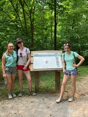 """""""It's a good experience,"""" said Reese Wineland, pictured left with Emma Mulligan and Emma Woods during a hike at House Mountain. """"It's fun to see the different cultures."""""""