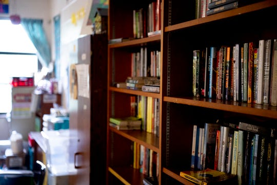 Over 2000 books are scattered about teacher Robin Bell's classroom at Gresham Middle School in Knoxville, Tennessee on Thursday, August 1, 2019. Bell is retiring after 30 years of teaching in Knox County Schools.