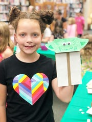 Morgan Lemmons with her completed Yoda hand puppet at the Star Wars-themed Block party on July 31, 2019.