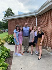 During the Ulster Project, the American host families got to visit different worship services with their Northern Irish guests. From left: Emma Mulligan, Emma Woods, Lon, Donna, Emory and Reese Wineland.
