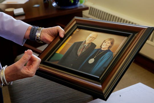 Marion Underwood, dean of the Purdue University College of Health and Human Sciences, holds a photo of her and her father, James, Thursday, Aug. 1, 2019 in West Lafayette.